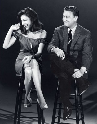 Nichols and May on bar stools.